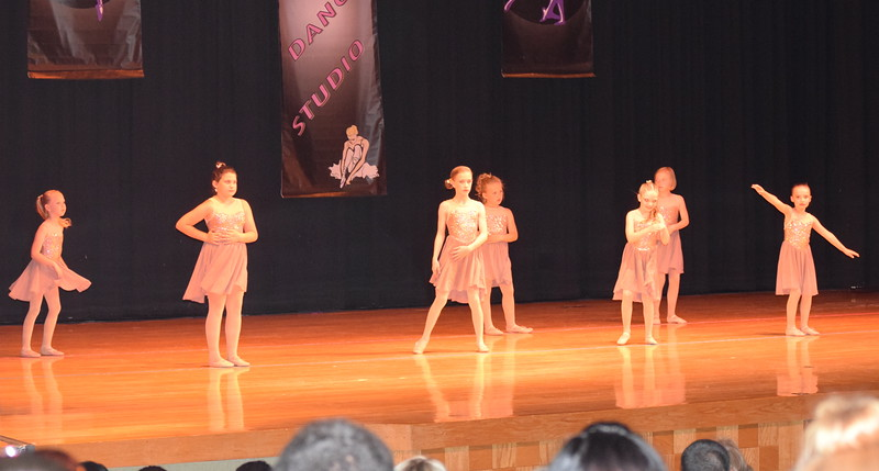 "Rylan Knorr, Layla Emerick, Makenzie Beck, Quinnlynn Parrish, Teagan Tennant, Kaina Carrasco, Bailey Swingle and Chloe Hutt dance to ""Because of You"" during Durante Dance Studio's spring recital, ""Wishes From Above,"" Friday, June 3, 2016."