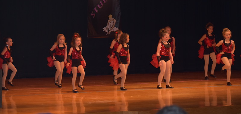 "Kaebrynn Heller, Bailey Workman, Hayden Walker, Katie Roberts, Josette Kerst, Taryn Seifried, Kaina Carrasco, Courtney Canada, Makenzie Beck, Kami Neel, Taylor Swan and Paige McCanley dance to ""Old Time Rock and Roll"" during Durante Dance Studio's spring recital, ""Wishes From Above,"" Friday, June 3, 2016."
