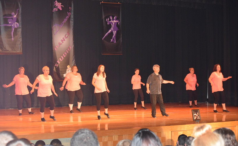 "Anne Kerst, Shawna Larson-Hernandez, Randy Finley, Misty Canada, McKenzie Crowe, Samantha Swan, Nicki Smith and Joyce Dizmang dance to ""Hold on Forever,"" in tribute to Tina Graber, who passed away earlier this year, during Durante Dance Studio's spring recital, ""Wishes From Above,"" Friday, June 3, 2016."