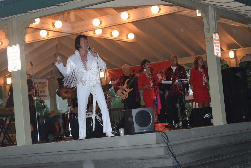 "George Gray and the Elvis Experience performed at the kick off for ""Transwest Concerts on the Green... JulyJamz"" Friday, July 1, 2016, despite the rain. The July concert series is presented by the Sterling Arts Council."