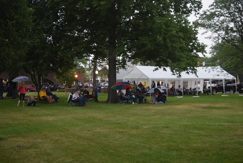 A small crowd braved the rain under umbrellas and tents to listen the music of George Gray and the Elvis Experience at the first concert in the July Jamz concert series Friday, July 1, 2016.