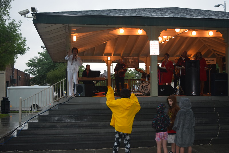 "Children enjoy the music of George Gray and the Elvis Experience at the  ""Transwest Concerts on the Green... JulyJamz"" Friday, July 1, 2016, despite the rain."