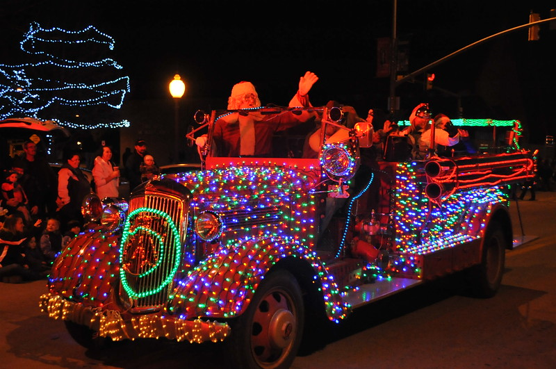 Santa waves to the crowd from his lighted fire truck to finish up the Parade of Lights Thursday, Dec. 4, 2014.
