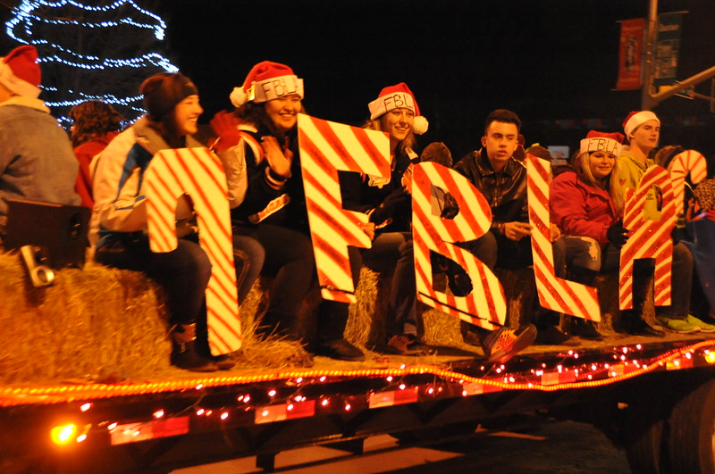FBLA members wave from their float in the Parade of Lights 2014.