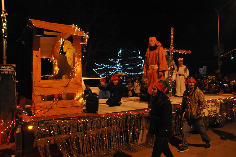 "Freedom Outreach invited parade-goers to ""Come Worship the King"" in the Parade of Lights."