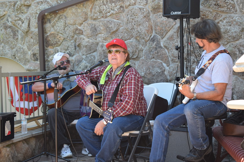 Arden Fennell, center, and F M Country perform for the crowd in the museum courtyard at the 2017 Heritage Festival.