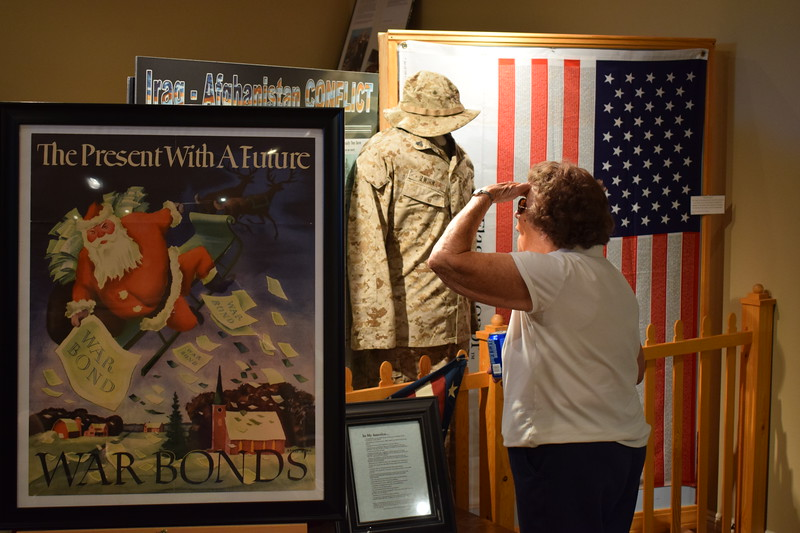 A guest looks over the military exhibit in the Dave Hamil Building of the Overland Trail Museum during the 2017 Heritage Festival.