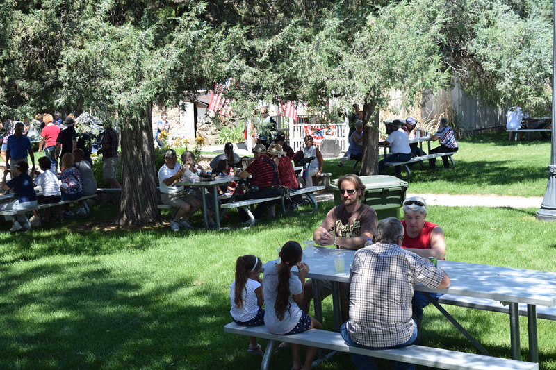 A crowd gathers in the Overland Trail Museum courtyard at lunchtime during the 2017 Heritage Festival.