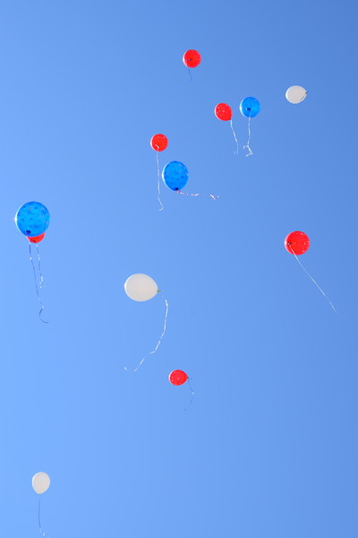 Red, white and blue balloons float into the sky after a balloon release that marked the end of the opening ceremonies at the Overland Trail Museum's annual Heritage Festival July 4, 2017.