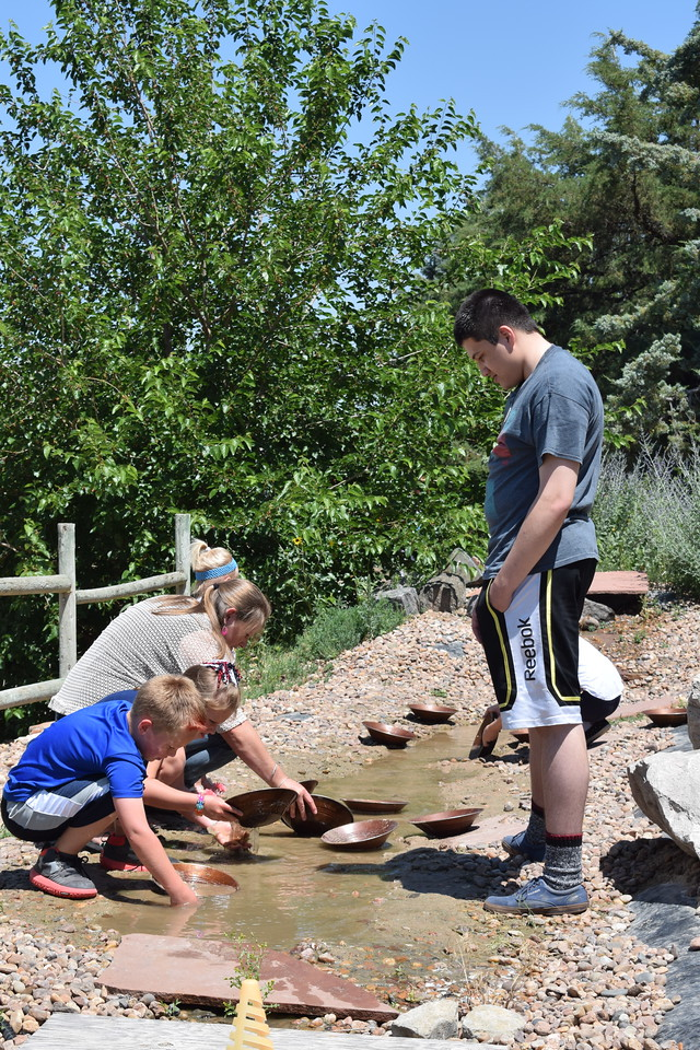 Guests enjoy gold panning during the 2017 Heritage Festival.