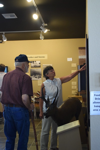 Guests look at an exhibit in the High Plains Education Center at the Overland Trail Museum's 2017 Heritage Festival.
