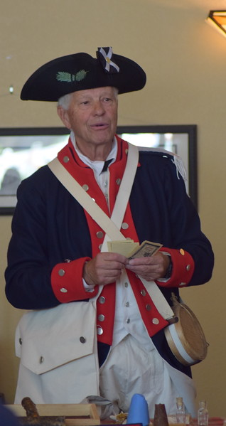 Bob Easterly of the Sons of the American Revolution talks about the money used in colonial America during a presentation at the Overland Trail Museum's Heritage Festival July 4, 2017.