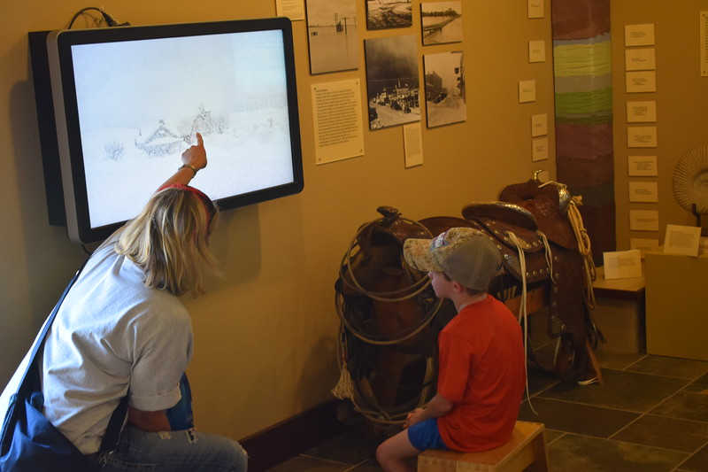 Visitors check out an interactive display about weather in the High Plains Education Center during the 2017 Heritage Festival.