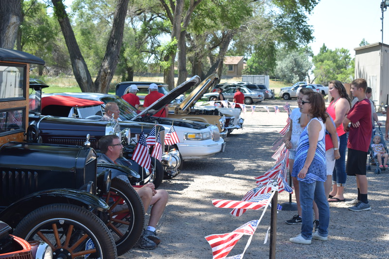 Guests check out the antique and classic cars on display during the 2017 Heritage Festival.