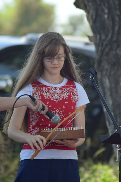 Playing the psaltery during the Barton Family performance at the Heritage Festival