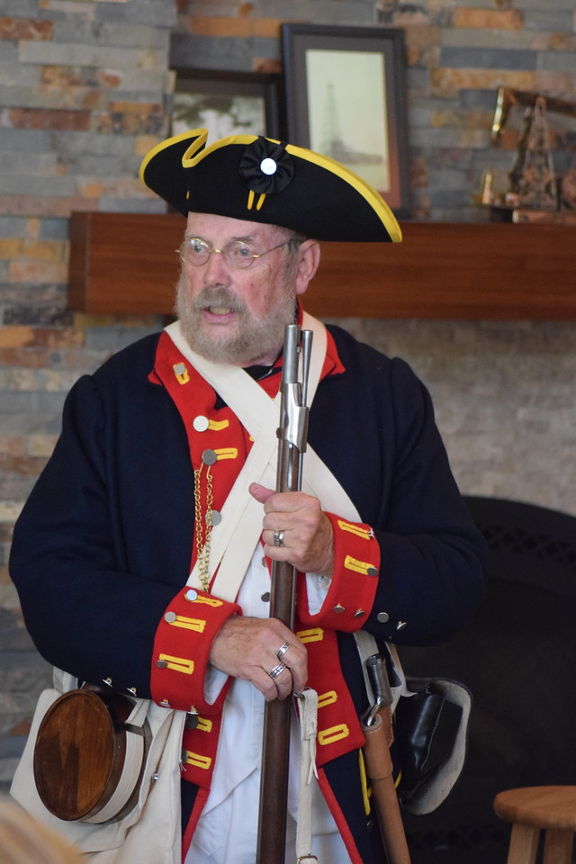 Walter Weart of the Sons of the American Revolution talks about his musket during a presentation at the Heritage Festival July 4, 2017.