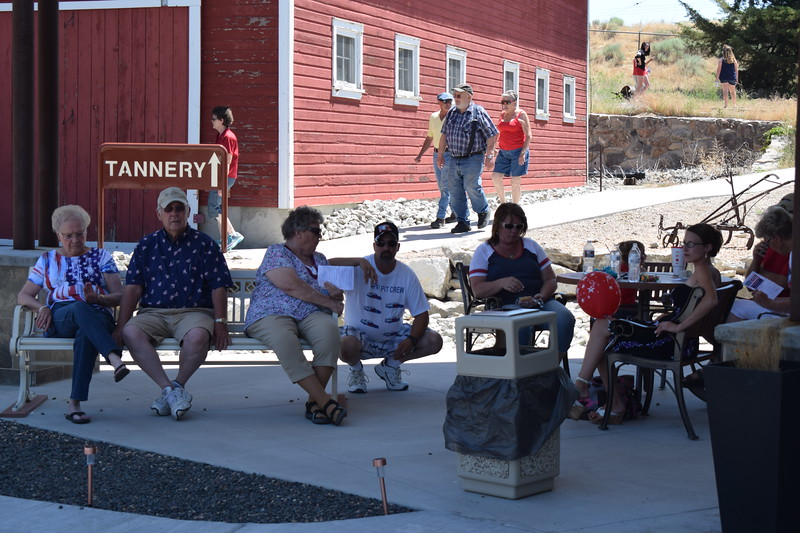 Visitors enjoy the shade on the High Plains Education Center patio during the 2017 Heritage Festival.