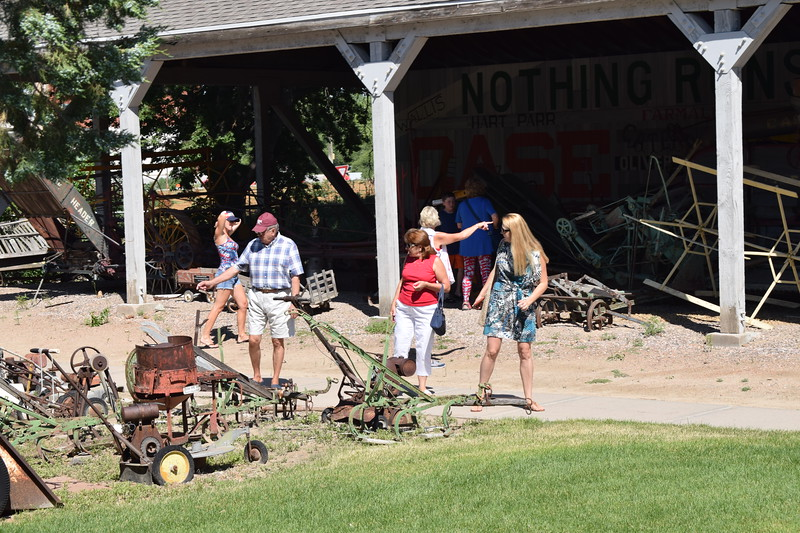 Heritage Festival-goers look over old farm equipment on exhibit at the Overland Trail Museum July 4, 2017.