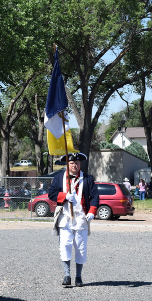 Rick Neely, a member of the Sons of the American Revolution, heads towards the High Plains Education Center at the Overland Trail Museum's Heritage Festival July 4, 2017.