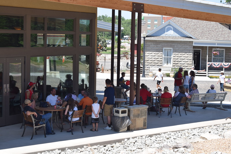 Visitors relax in the shade on the patio of the High Plains Education Center during the 2017 Heritage Festival.