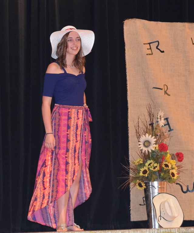 . Shelby Houser models her beach outfit in the Senior Division of the Logan County Fair 4-H Fashion Revue Friday, Aug. 3, 2018. She will represent Logan County at the Colorado State Fair.