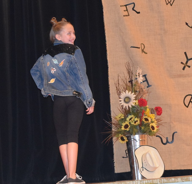 Ayla Baney models her outfit in the Intermediate Division of the Logan County Fair 4-H Fashion Revue Friday, Aug. 3, 2018.