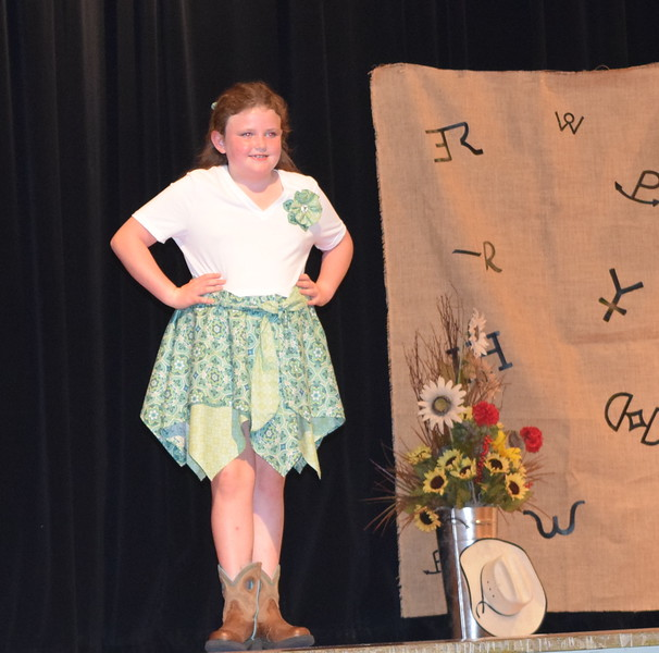 Ailey Paxton models her bandana dress in the Junior Division of the Logan County Fair 4-H Fashion Revue Friday, Aug. 3, 2018.