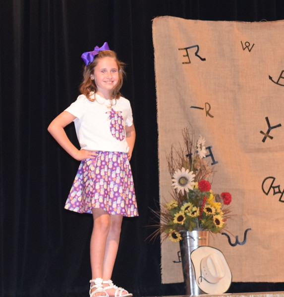 Taylor Tribbett models her pinapple dress in the Junior Division of the Logan County Fair 4-H Fashion Revue Friday, Aug. 3, 2018.