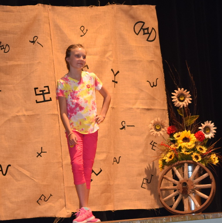 . Kayti Williams models her pant and shirt outfit in the Junior Division of the Logan County Fair 4-H Fashion Revue Friday, Aug. 3, 2018.
