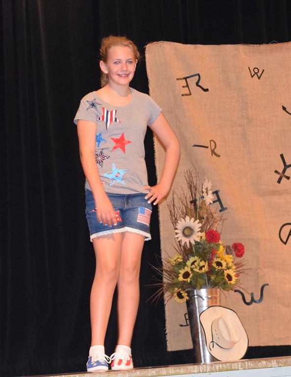 . Ashton Nichols models her patriotic outfit in the Intermediate Division of the Logan County Fair 4-H Fashion Revue Friday, Aug. 3, 2018. She was named Reserve Champion in the division.