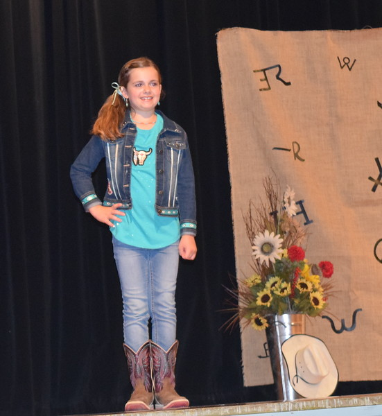 Hadley Stull models her outfit in the Junior Division of the Logan County Fair 4-H Fashion Revue Friday, Aug. 3, 2018.
