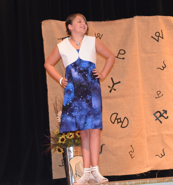 Mattea Pelton models her dress in the Junior Division of the Logan County Fair 4-H Fashion Revue Friday, Aug. 3, 2018.
