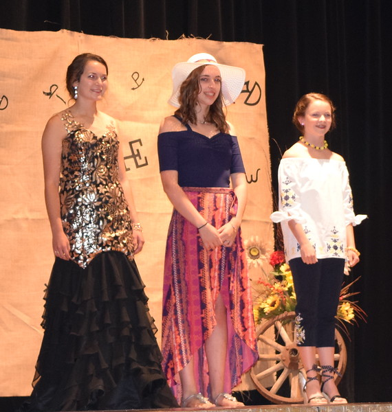 Contestants in the Senior Division of the Logan County Fair 4-H Fashion Revue Friday, Aug. 3, 2018, model their outfits. From left; Rachael Northup, Champion, Shelby Houser, Aly Young, Reserve Champion.