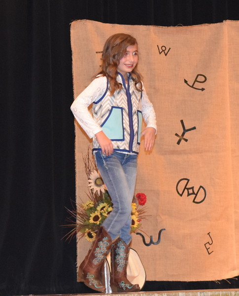 Alexis Gentry models her outfit in the Junior Division of the Logan County Fair 4-H Fashion Revue Friday, Aug. 3, 2018.