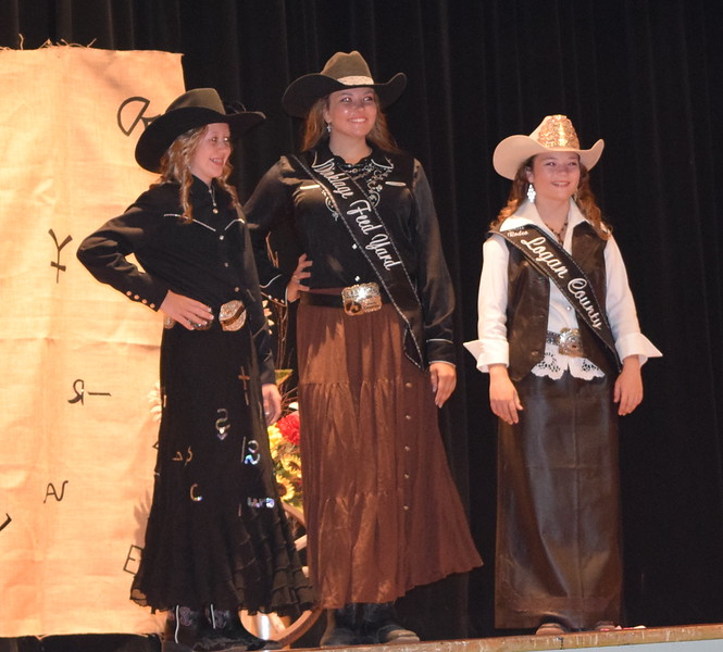 Logan County Fair royalty model their outfits at the 4-H Fashion Revue Friday, Aug. 3, 2018. From left; Tobi-Beth Erickson, Miss Rodeo Logan County Sweetheart 2018; Brooke Sigmon, Miss Rodeo Logan County 2019 Contestant; and Morgan Duncan, Miss Rodeo Logan County 2018.