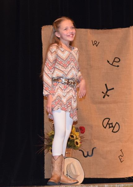 Ayla Baney models her outfit in the Encore Division of the Logan County Fair 4-H Fashion Revue Friday, Aug. 3, 2018.