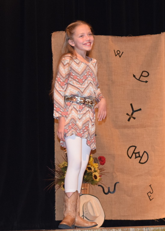 . Ayla Baney models her outfit in the Encore Division of the Logan County Fair 4-H Fashion Revue Friday, Aug. 3, 2018.