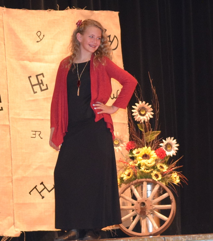 . Ashton Nichols models her outfit in the Encore Division of the Logan County Fair 4-H Fashion Revue Friday, Aug. 3, 2018.