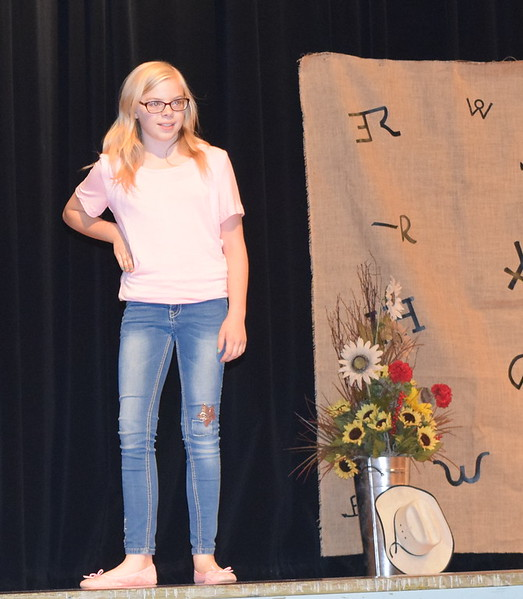 Sadie Fehringer models her outfit in the Intermediate Division of the Logan County Fair 4-H Fashion Revue Friday, Aug. 3, 2018.