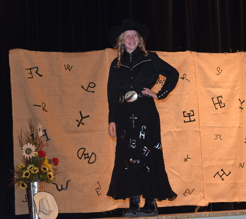 . Miss Rodeo Logan County Sweetheart 2018 Tobi-Beth Erickson models her outfit during the Logan County Fair 4-H Fashion Revue Friday, Aug. 3, 2018.