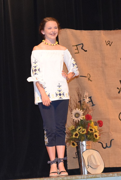 Aly Young models her shirt and pants outfit in the Senior Division of the Logan County Fair 4-H Fashion Revue Friday, Aug. 3, 2018. She was named Reserve Champion in the division and will represent Logan County at the Colorado State Fair.