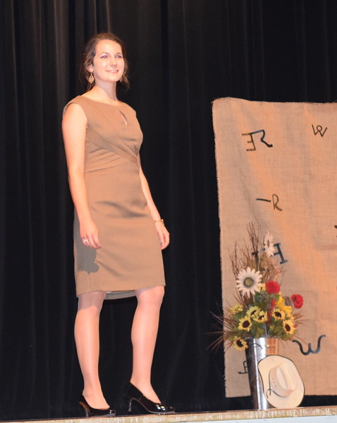 Rachael Northup models her dress in the Senior Division of the Logan County Fair 4-H Fashion Revue Friday, Aug. 3, 2018.