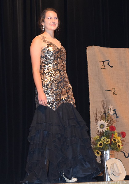 Rachael Northup models the prom dress she made during the Senior Division of the Logan County Fair 4-H Fashion Revue Friday, Aug. 3, 2018. She was named Champion of the division and will represent Logan County at the Colorado State Fair.