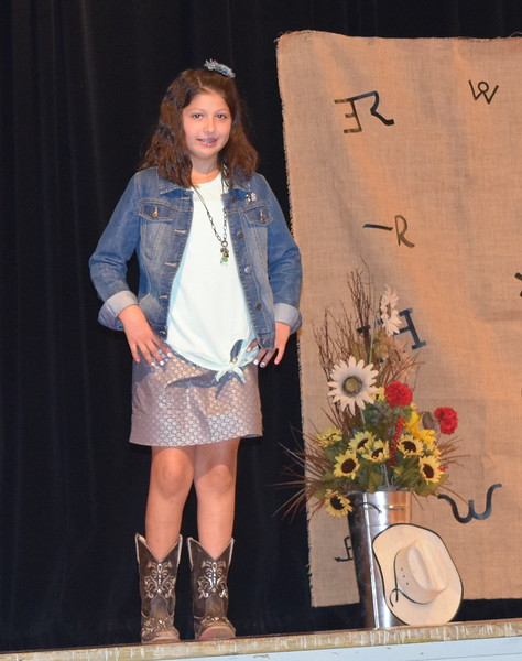 Addison Koester models her outfit in the Junior Division of the Logan County Fair 4-H Fashion Revue Friday, Aug. 3, 2018.