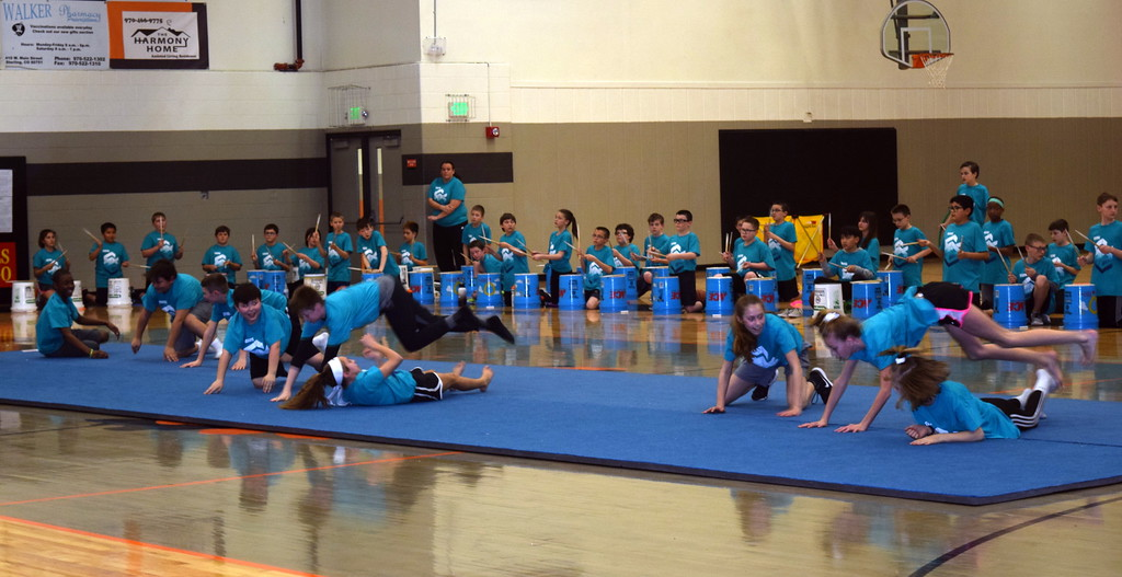 . Students show their athletic abilities as they jump over each other at Campbell Elementary\'s annual 5th Grade Music and P.E. Showcase Tuesday, March 12, 2019.