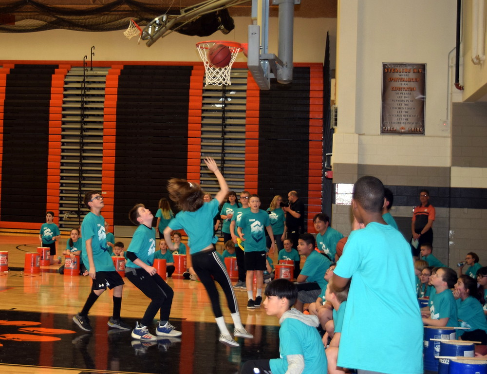 . Students show off their basketball skills at Campbell Elementary\'s annual 5th Grade Music and P.E. Showcase Tuesday, March 12, 2019.