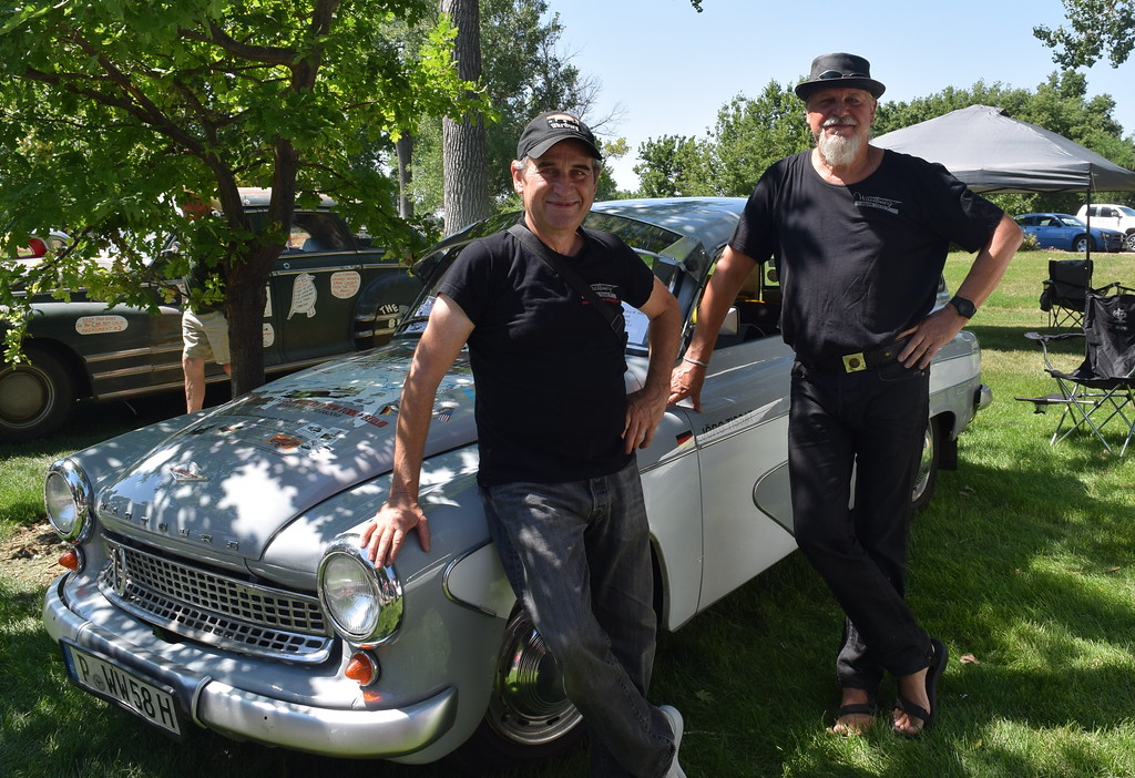 ". Jorg Tissat, left, and his traveling companion Frank Lucas pose for a photo next to ""Willy,\"" a Wartburg 311 Camping Limousine the two Germans are driving across America on a charity challenge. They stoped in Sterling on Saturday, July 7, 2018, to take part in the Colorado Flatlanders Rod Run in the Park."