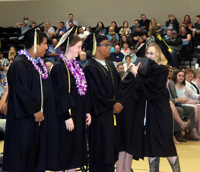Jamie Kielian is congratulated by her fellow graduates after receiving her diploma at Caliche High School's Commencement Ceremony Saturday, May 25, 2019.