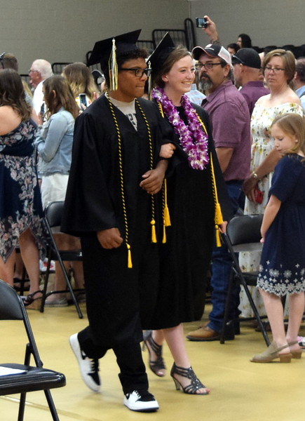 Traevonn Walton and Rachel Fryrear make their way to their seats at Caliche High School's Commencement Ceremony Saturday, May 25, 2019