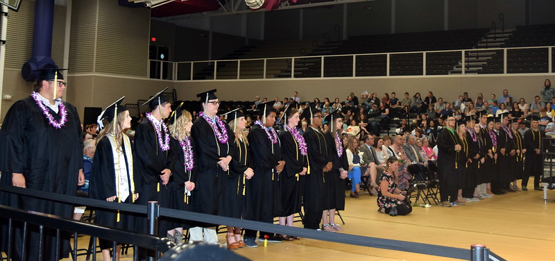 Caliche High School graduates rise to receive their diplomas at the school's commencement ceremony Saturday, May 25, 2019. The class of 2019 has 20 graduates.